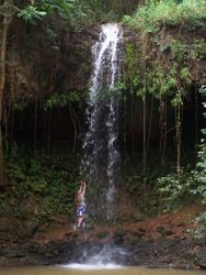 Hula dancer Elizabeth Ann pays homage to the waterfall