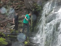 Father and son at the waterfall