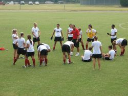 Speaking with Belmont Abbey College team after training