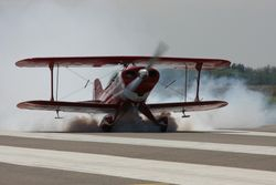 Tom Rybarczyk's Pitts S1S with smoke on for takeoff