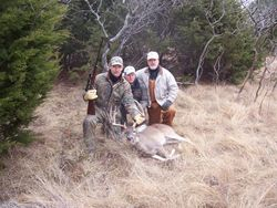 Two son's, John lll, Chancey and Dad  hunting on Buxton ranch.