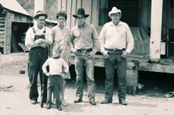"""Picture of Willie York, Nellie Yory with their grandson """"Froggie"""" along with My self and Kid Marley in front of Willie's house on the Big East Fork."""