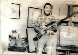 In my old art studio, Showing a rifle I engraved.