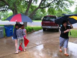 More than 20 of us ducked into the garage when it started to rain. Finally, we had to give up and call the parents.