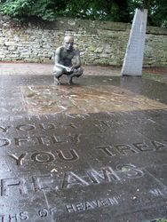 """Statue of man contemplating Yeats' poem """"He Wishes for the Cloths of Heaven"""""""