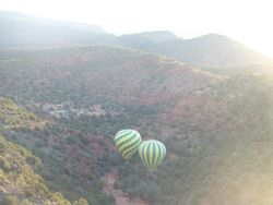 Two balloons in the hills