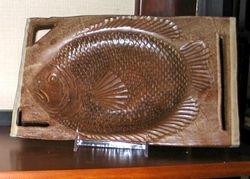 Brown fish dish - sold
