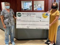 Davies Martin REMC donates Funds