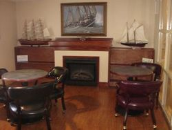 Fireplace & Bookcase in Schooner Lounge