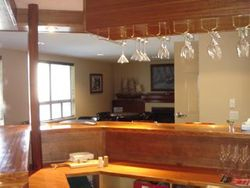 Mahogany prow shaped bar in Schooner Lounge