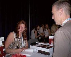 Melanie signing