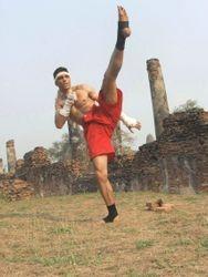 MASTER DANNY SHOWING NARAI BAN SEAN  - HIGH SIDE ANGLE SHIN KICK TO HEAD