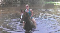 Raini loves a freshing swim in the river.