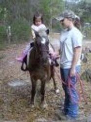 Ashley & Angel Giving A Pony Ride