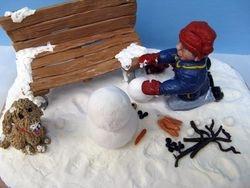 Travis Building a Snowman 5