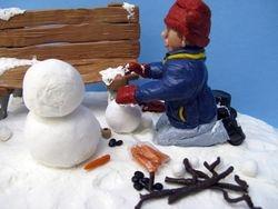 Travis Building a Snowman 7