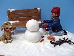 Travis Building a Snowman 10