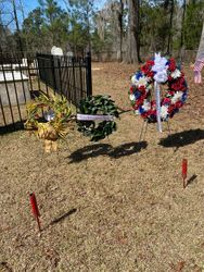 Wreaths at his grave