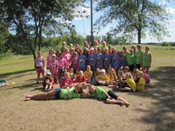2014 Girl Scouts gathered around the flag pole