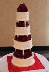Wedding Cake with Pillars and Red Roses