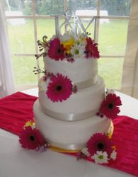 3 Tiered Round Wedding Cake and Gerber Daisies