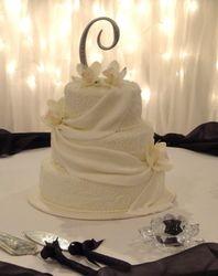 Fondant Drapes & White Orchids Wedding Cake