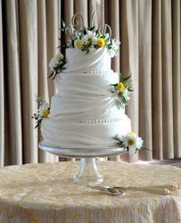 4 Tiered Wedding cake with fondant draping