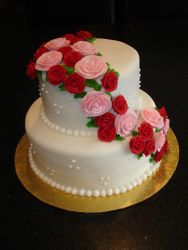 Cascade of Pink & Red Roses Wedding Cake
