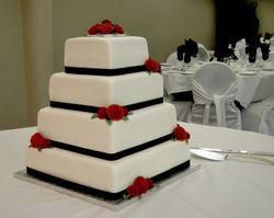 White and Black Wedding Cake with Red Roses
