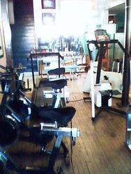 Den installs wood floor gym