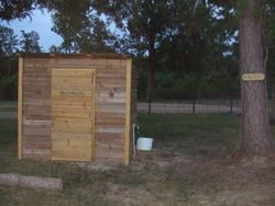 Restroom By arena with hitching post