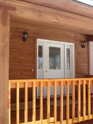 Covered porch and beautiful entry door