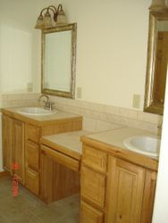 Double master bathroom sinks and custom tile work