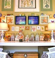 Create a collage of framed art and related items