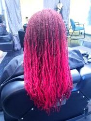 Dyed the extension red and attached to broken sisterlocs to even out locs overall