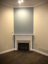 New corner fireplace with custom mantel