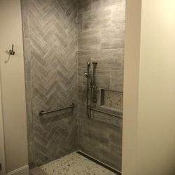 Completely new shower with custom pan with linear floor drain and custom tile