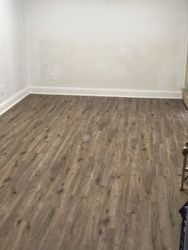 New floor in garage that was turned into a exercise room