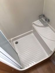 shower tray in cubicle