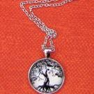 Unique silver-toned glass Tree of Life Pendant with neck chain.