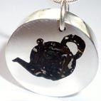 Silver, tea and resin jewellery. Handmade