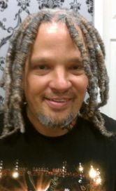 Client happy after repaired with Braids by Bee technique of InstantLoc Dread Extensions technique.