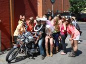 this Nashville Bachleorette Party poses with a local while on the Music City Pub Crawl