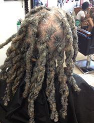 InstantLoc Dread Extensions technique used to repair unruly dreadlocks.