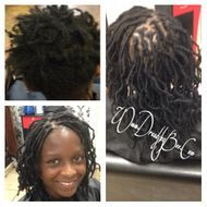 Sisterloc Dread Extensions permanent hairstyle done on young teens hair that was breaking and wanted natural locs she had a smile on her face when done.  She loves her new sisterloc dreads