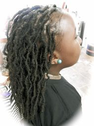Braids by Bee starts InstantLoc Dread Extensions on kids hair.
