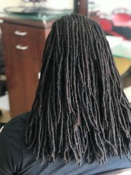 Braids by Bee repairs dreadlocks for clients with natural long thin sisterlocs