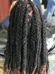 Dreads by Bee done at Braids by Bee salon, known to repair and maintain dreadlocks with her own unconventional methods.