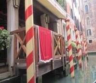"<img src=""australian womens travel.jpg alt=stroied red and white boat poles, venice, italy , italy"">"