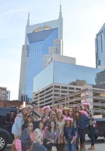 Lauren's group poses with the batman building in the back